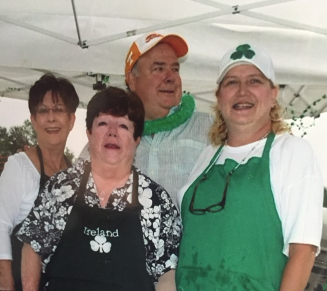 Colleen, in green, with husband and members of the food team.